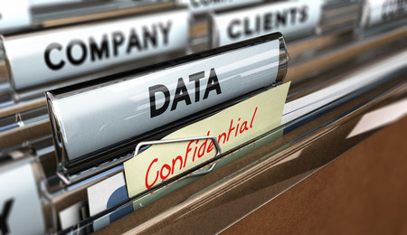 Data security - close up on a file tab with the word data and confidential, focus on the main text and blur effect.
