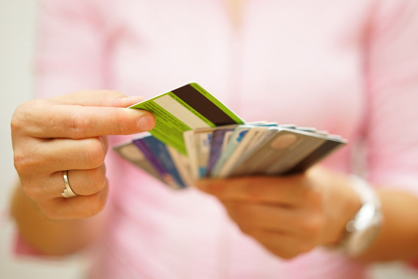 Tips for choosing a business credit card - woman choosing one credit card from many