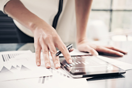 6 Essential accounting terms - a woman reading financial reports with tablet
