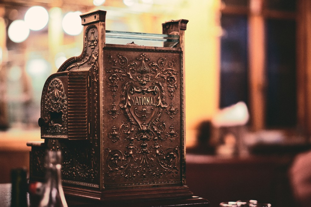 Setting payment terms for your small business - photo of brown vintage cash register