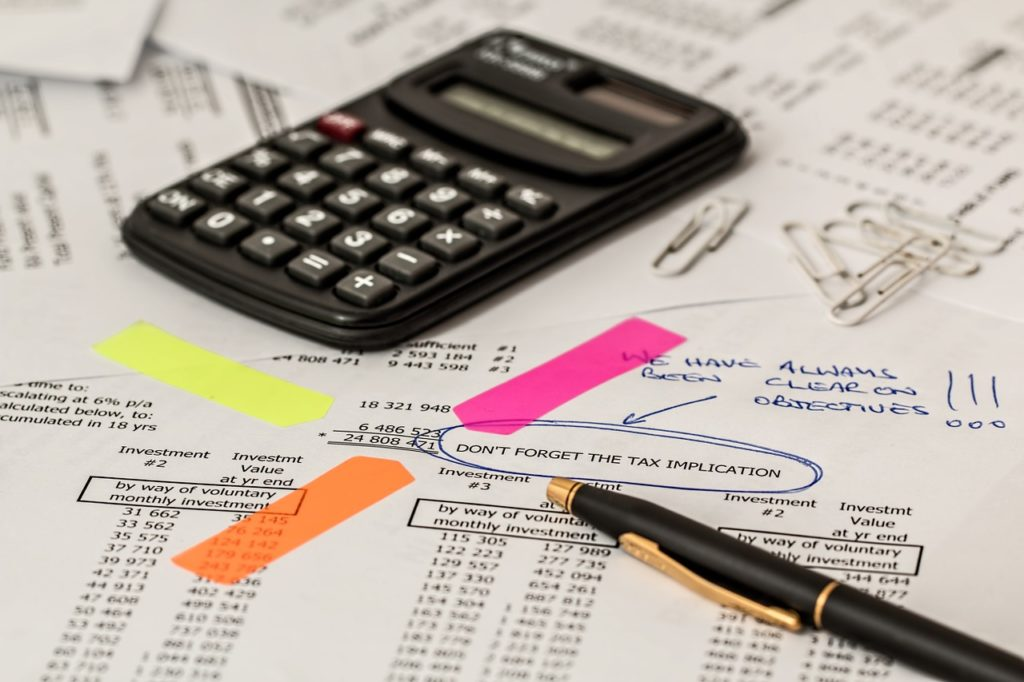 Why Bookkeeping is Crucial to Your Success - pen and calculator on financial reports