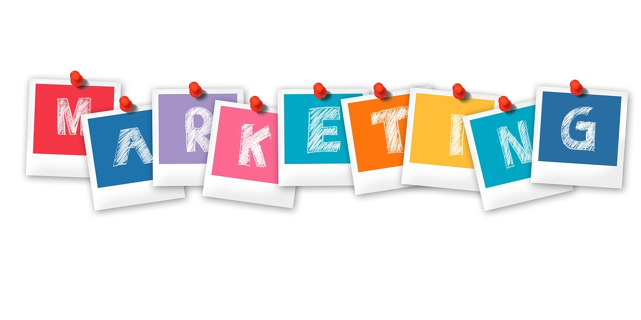 """Tips to continue marketing on a shoestring budget - the word """"marketing"""" as a series of Polaroid prints pinned up in a row"""