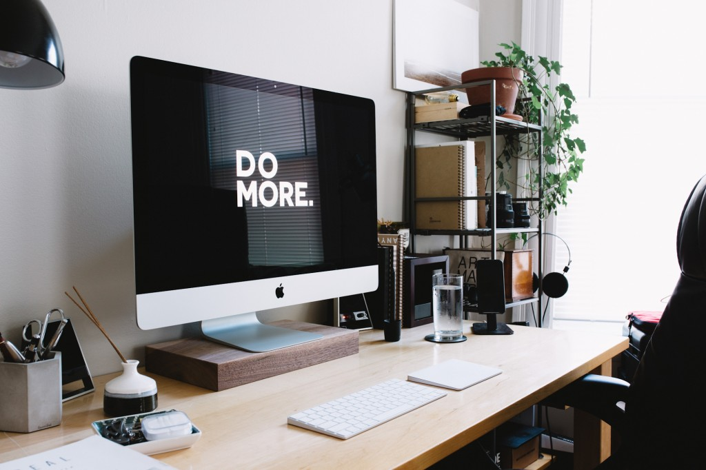"""4 Tips for Getting Your Business Through Hard Times - computer screen in small business office with the words """"DO MORE"""""""