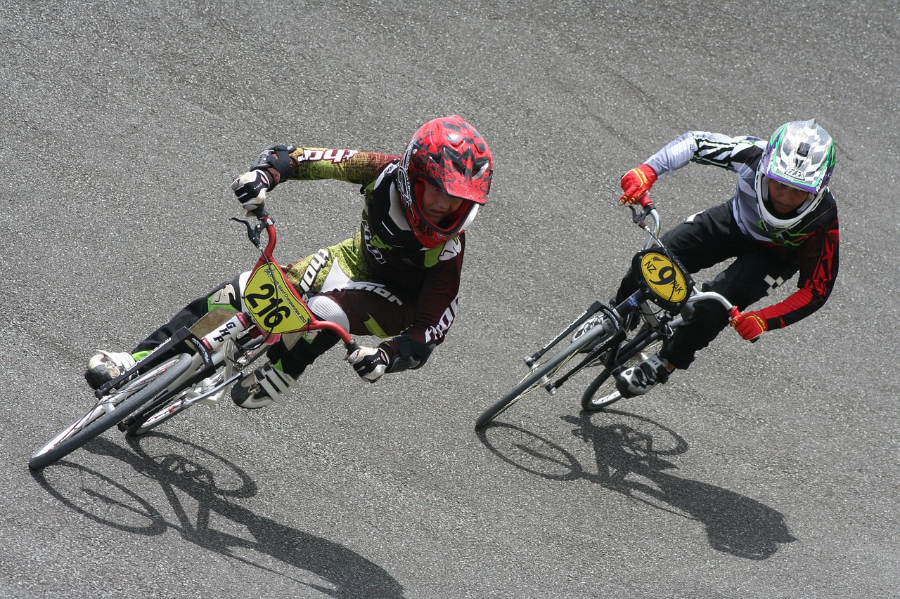 4 ways a small start up can take on established competitors - a cyclist in a race catches up with the leader