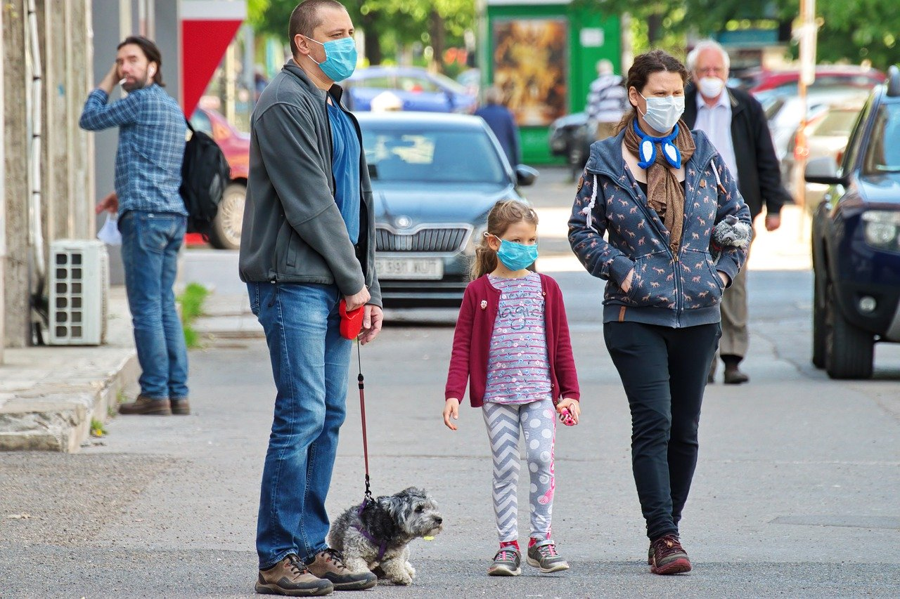 COVID-19 Business Update - 22 May 2020 - People walking in public wearing face masks.