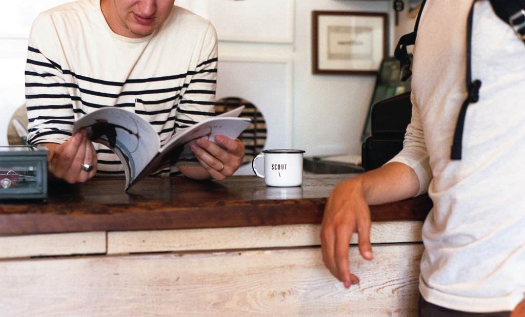 How to employ casual workers - casual worker leaning on counter while looking at a magazine