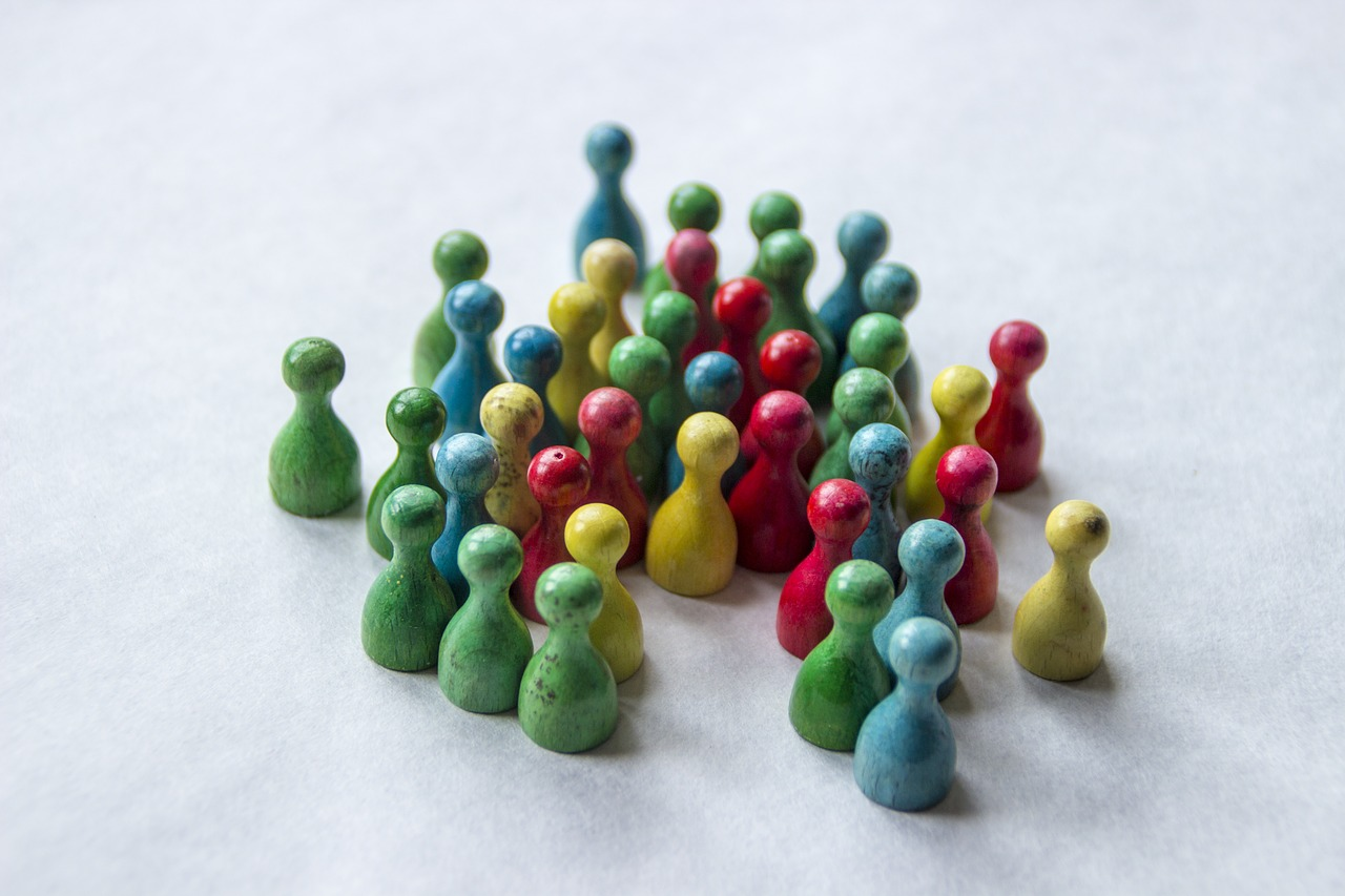 Four great ways to get more leads for your business - a crowd of green, blue, yellow and red pawns.