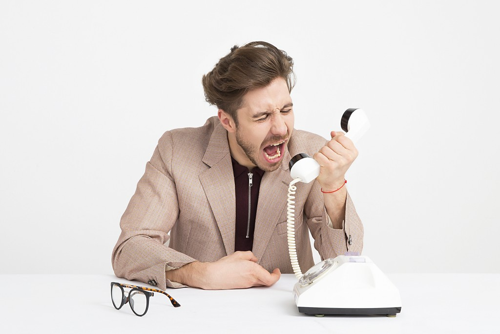 Three terrible management habits - man screaming into telephone receiver