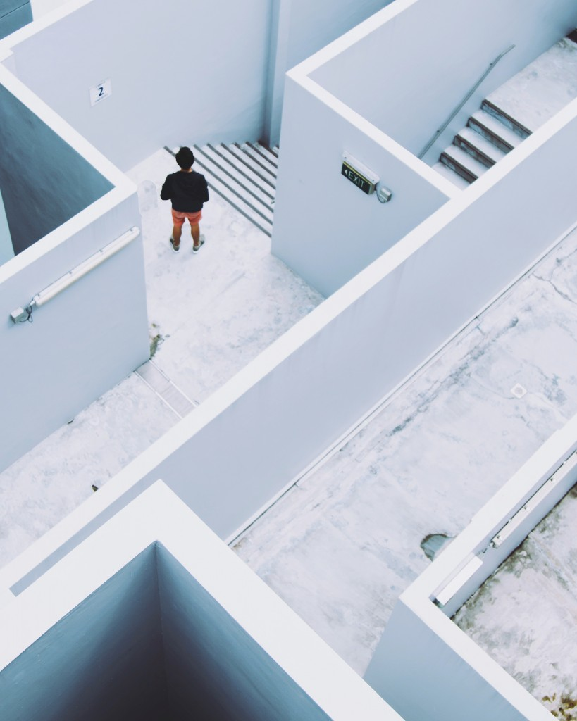 How to learn from failure in business - man standing in maze-like building