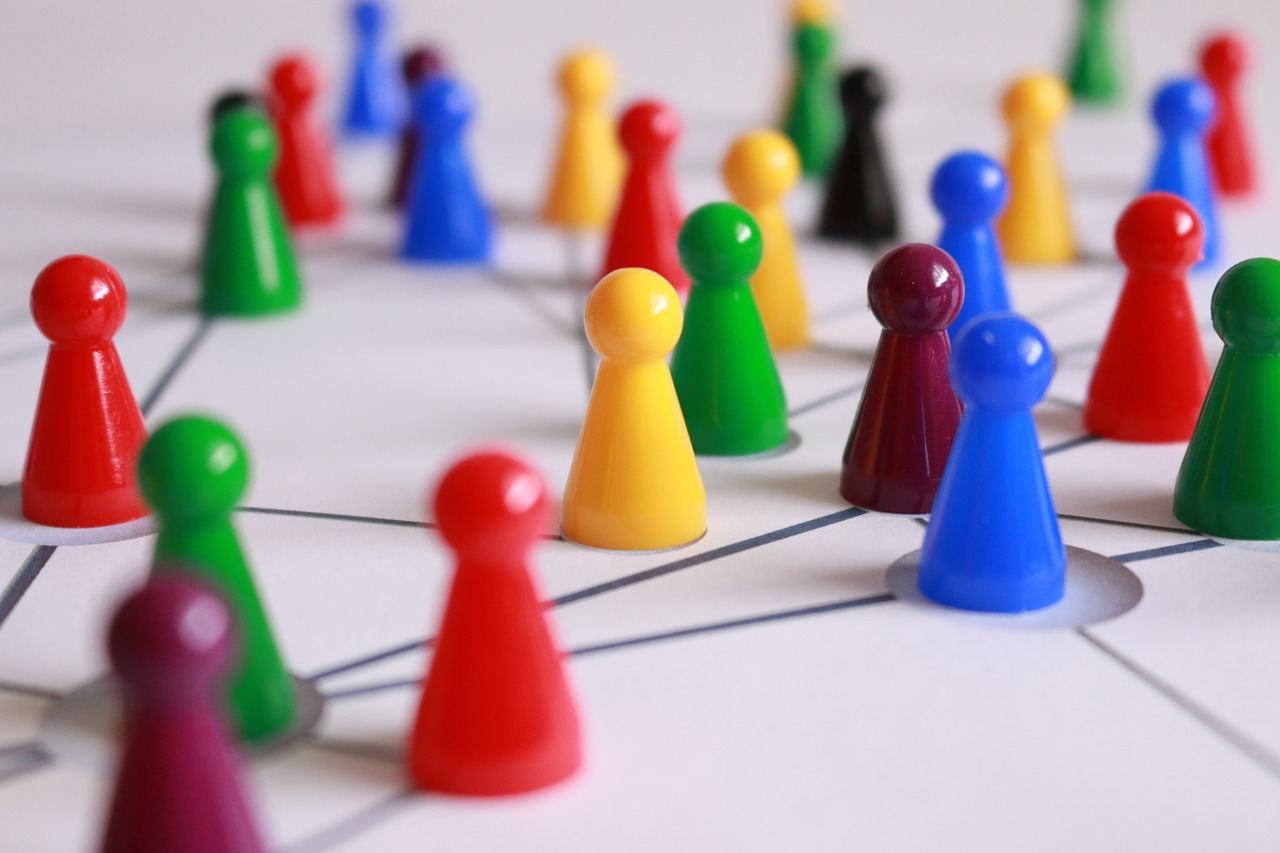 Growing your network without networking events - coloured pawns connected by straight lines