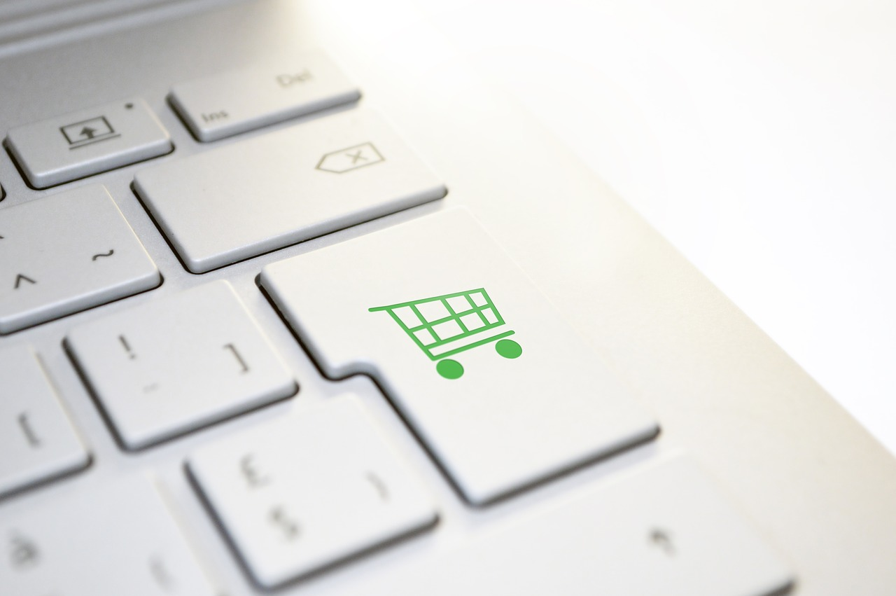 How small businesses boost sales during Covid-19 - a laptop keyboard with a shopping trolley icon marking the enter key