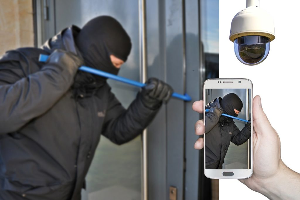 Five Effective Risk Control Strategies - a burglar caught on a phone camera